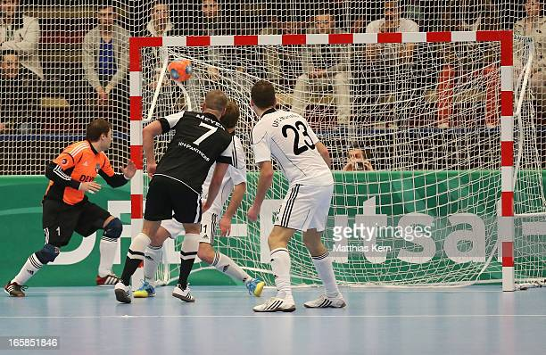 Michael Meyer of Hamburg scores a goal during the DFB Futsal Cup final match between Hamburg Panthers and UFC Muenster at Sporthalle Wandsbek on...