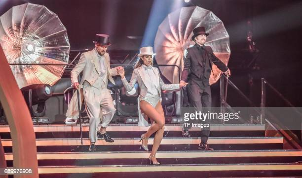 Michael Michalsky Heidi Klum and Thomas Hayo performs during the final of Germanys Next Top Model TV show at KönigPilsenerArena on May 25 2017 in...