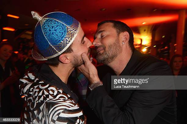 Michael Michalsky seen kissing an unidentified man at the Michalsky Style Night during MercedesBenz Fashion Week Autumn/Winter 2014/15 at Tempodrom...