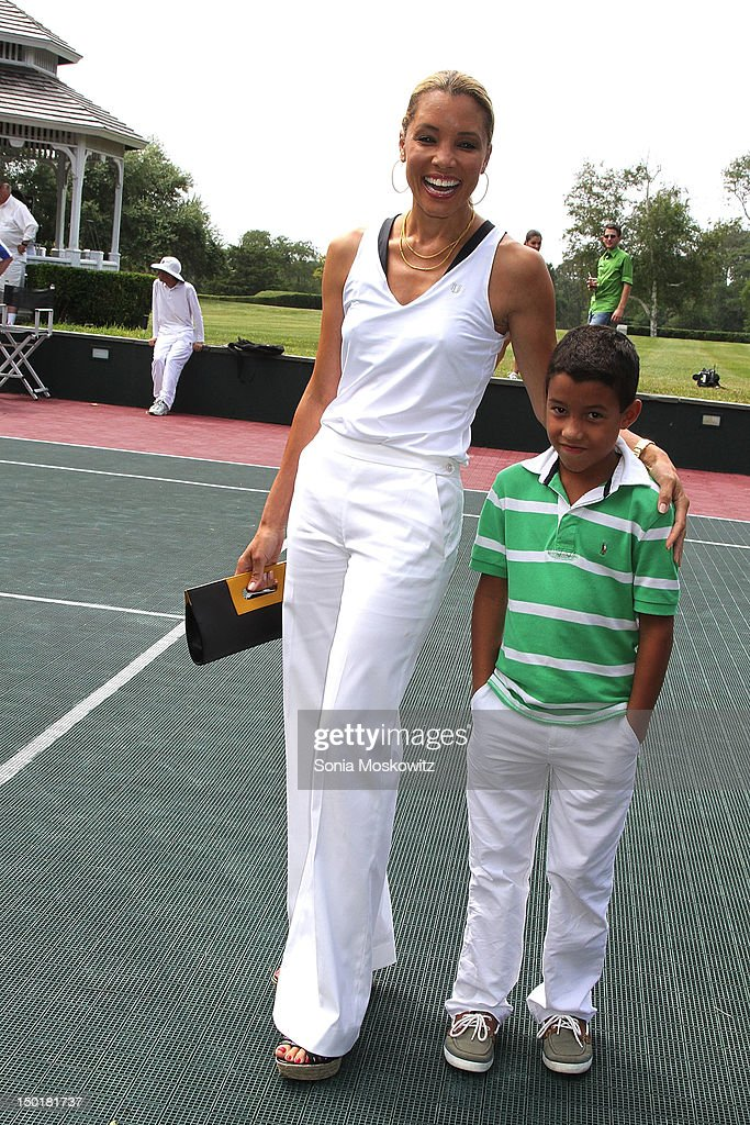 Michael Michele and son J. Brandon attend the EleVen by Venus Williams party on August 11, 2012 in Southampton, New York.