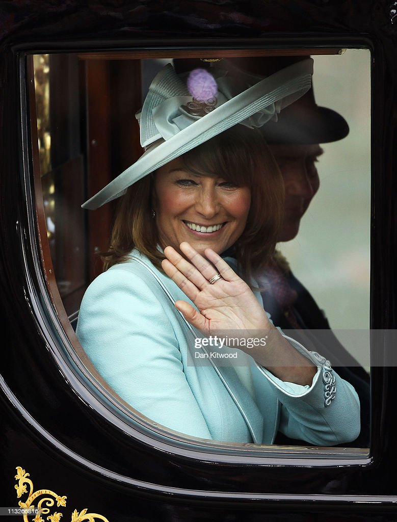 Michael Middleton and <a gi-track='captionPersonalityLinkClicked' href=/galleries/search?phrase=Carole+Middleton&family=editorial&specificpeople=4079988 ng-click='$event.stopPropagation()'>Carole Middleton</a> ride in a carriage procession to Buckingham Palace following the marriage of Their Royal Highnesses Prince William Duke of Cambridge and Catherine Duchess of Cambridge at Westminster Abbey on April 29, 2011 in London, England. The marriage of the second in line to the British throne was led by the Archbishop of Canterbury and was attended by 1900 guests, including foreign Royal family members and heads of state. Thousands of well-wishers from around the world have also flocked to London to witness the spectacle and pageantry of the Royal Wedding.