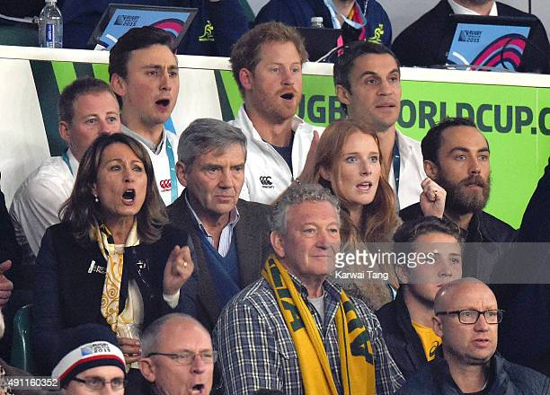 Michael Middleton Carole Middleton Prince Harry and James Middleton attend the England v Australia match during the Rugby World Cup 2015 on October 3...