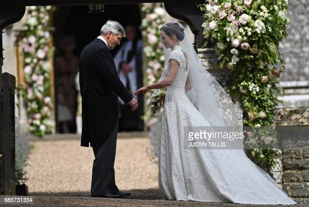 TOPSHOT Michael Middleton stands with his daughter Pippa Middleton as they arrive for her wedding to James Matthews at St Mark's Church in Englefield...