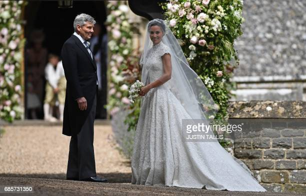 Michael Middleton stands with his daughter Pippa Middleton as they arrive for her wedding to James Matthews at St Mark's Church in Englefield west of...