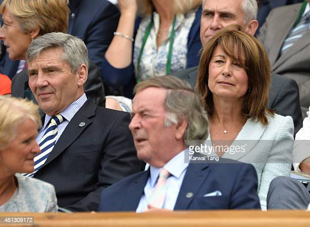 Michael Middleton Terry Wogan and Carole Middleton attend the Noval Djokovic v Gilles Simon match on centre court during day five of the Wimbledon...