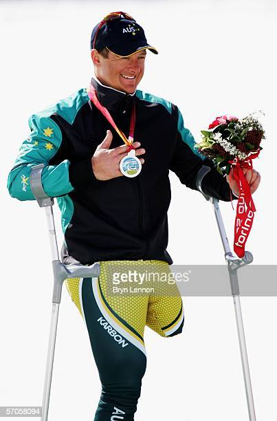 Michael Milton of Australia celebrates taking the silver medal during the Standing Men's Downhill Skiiing Competiton on day one of the 2006 Turin...