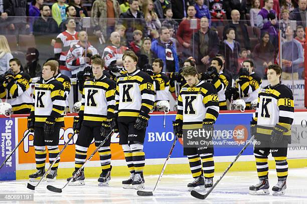 Michael Moffat Evan McEneny Lawson Crouse Darcy Greenaway and Robert Polesello of the Kingston Frontenacs stand during the singing of the national...