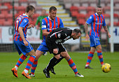Michael Moffat of Dunfermline Athletic FC is tackled by Garry Warren of Inverness Caledonian Thistle FC during the Betfred Cup match between...