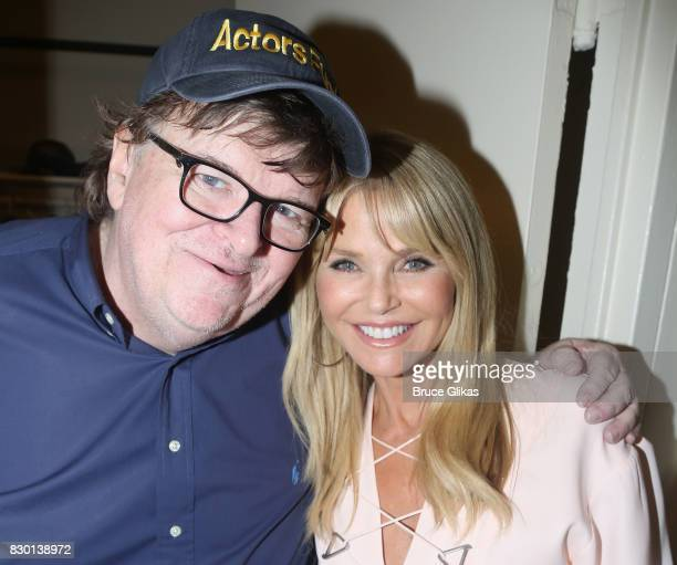 Michael Moore and Christie Brinkley pose backstage at the opening night of 'Michael Moore 'The Terms Of My Surrender' on Broadway at The Belasco...