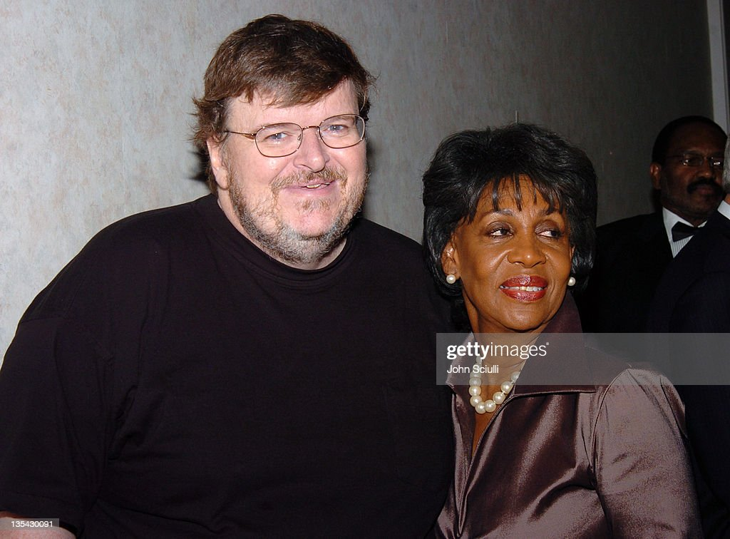 Michael Moore and Congresswoman <a gi-track='captionPersonalityLinkClicked' href=/galleries/search?phrase=Maxine+Waters&family=editorial&specificpeople=220525 ng-click='$event.stopPropagation()'>Maxine Waters</a> during Rainbow Push Coalition Dinner to Celebrate Rev. Jesse Jackson at Beverly Hilton Hotel in Beverly Hills, California, United States.