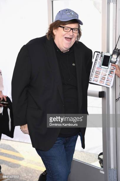 Michael Moore attends the Turner Upfront 2017 arrivals on the red carpet at The Theater at Madison Square Garden on May 17 2017 in New York City...