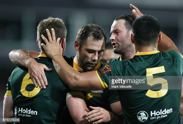 Michael Morgan of Australia celebrates scoring a try with team mates during the 2017 Rugby League World Cup Quarter Final match between Australia and...