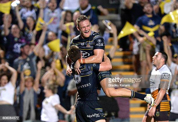Michael Morgan of the Cowboy is congratulated by team mate Coen Hess after scoring a try during the first NRL semi final between North Queensland...
