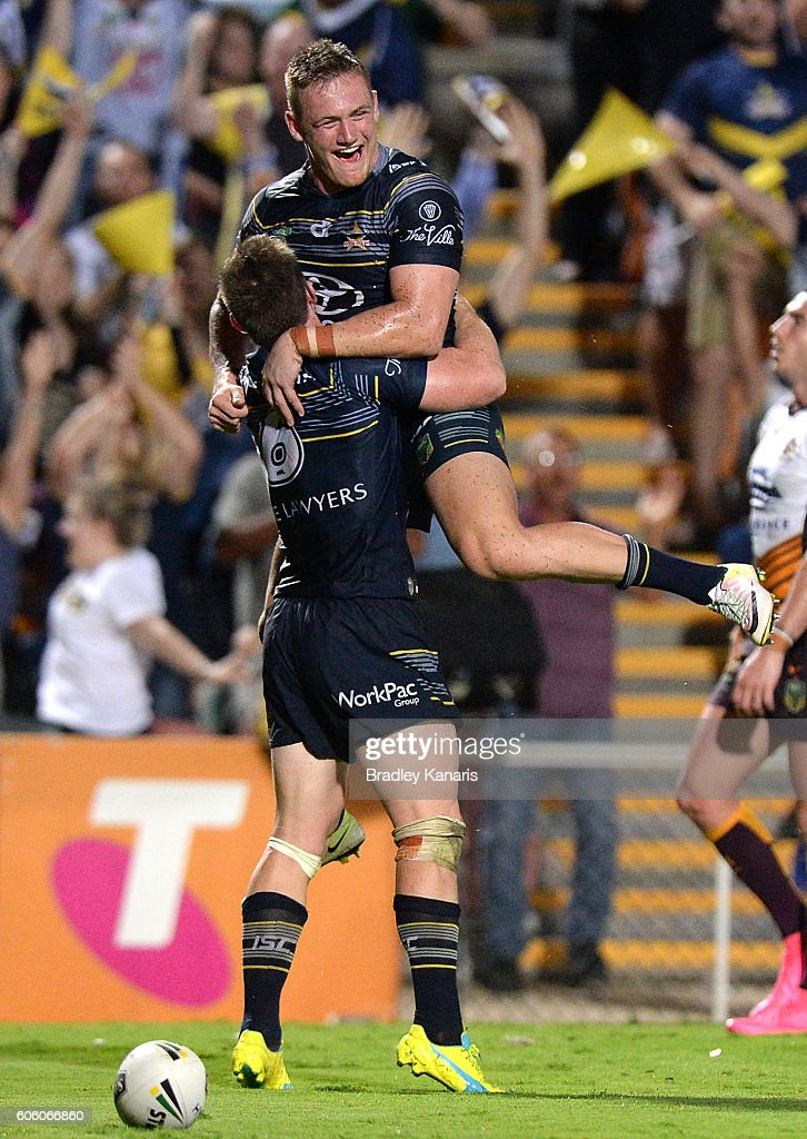 Michael Morgan of the Cowboy is congratulated by team mates after scoring a try during the first NRL semi final between North Queensland Cowboys and Brisbane Brisbane at 1300SMILES Stadium on September 16, 2016 in Townsville, Australia.