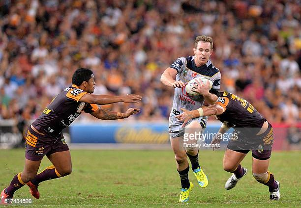 Michael Morgan of the Cowboys attempts to break through the defence during the round four NRL match between the Brisbane Broncos and the North...