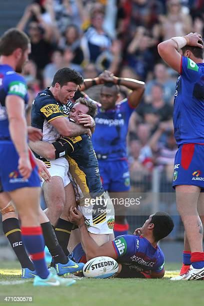 Michael Morgan of the Cowboys celebrates a try with a team mate during the round eight NRL match between the Newcastle Knights and the North...