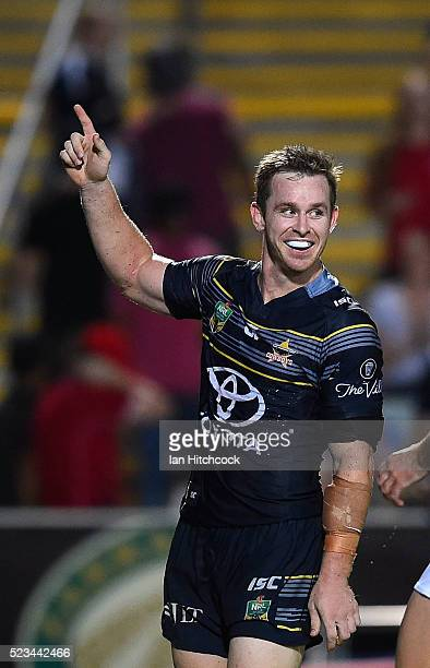 Michael Morgan of the Cowboys celebrates after scoring a try during the round eight NRL match between the North Queensland Cowboys and the Parramatta...