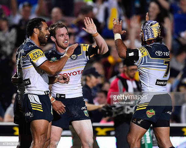 Michael Morgan of the Cowboys celebrates after scoring a try with Justin O'Neil and Johnathan Thurston of the Cowboys during the round 10 NRL match...