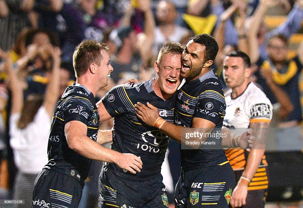 Michael Morgan of the Cowboys celebrates with team mates Justin O'Neill and Coen Hess after scoring a try during the first NRL semi final between North Queensland Cowboys and Brisbane Brisbane at 1300SMILES Stadium on September 16, 2016 in Townsville, Australia.