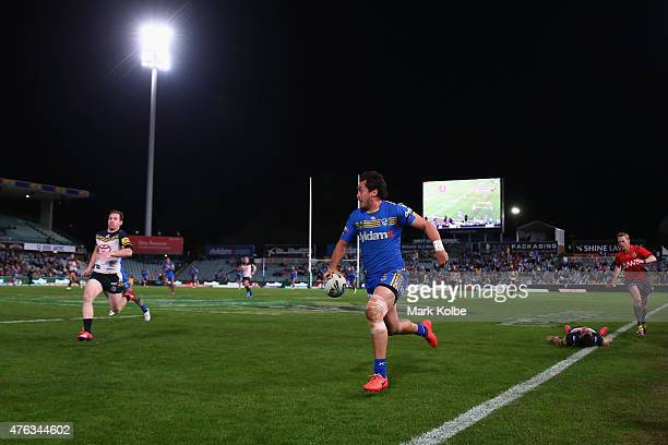 Michael Morgan of the Cowboys chases Brad Takairangi of the Eels as he makes a break during the round 13 NRL match between the Parramatta Eels and...