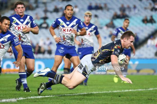 Michael Morgan of the Cowboys dives to score a try during the round 10 NRL match between the Canterbury Bulldogs and the North Queensland Cowboys at...