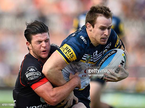 Michael Morgan of the Cowboys is tackled by Chad Townsend of the Warriors during the round seven NRL match between the North Queensland Cowboys and...