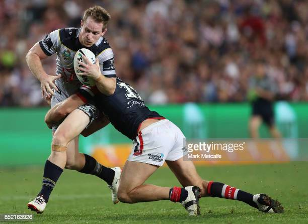 Michael Morgan of the Cowboys is tackled during the NRL Preliminary Final match between the Sydney Roosters and the North Queensland Cowboys at...