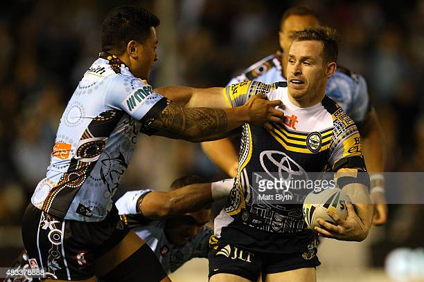 Michael Morgan of the Cowboys is tackled during the round 22 NRL match between the Cronulla Sharks and the North Queensland Cowboys at Remondis...