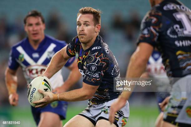 Michael Morgan of the Cowboys passes during the round 10 NRL match between the Canterbury Bulldogs and the North Queensland Cowboys at ANZ Stadium on...