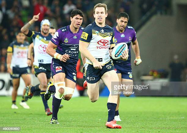 Michael Morgan of the Cowboys runs away to score a try during the NRL Second Preliminary Final match between the Melbourne Storm and the North...