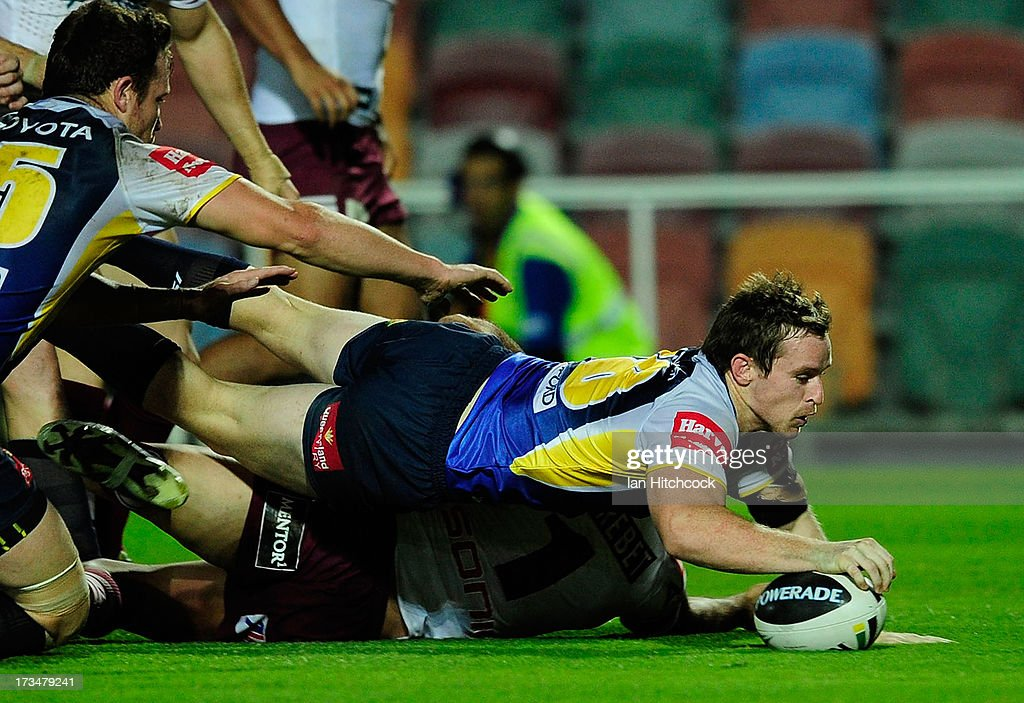 Michael Morgan of the Cowboys scores a try during the round 18 NRL match between the North Queensland Cowboys and the Manly Sea Eagles at 1300SMILES Stadium on July 15, 2013 in Townsville, Australia.