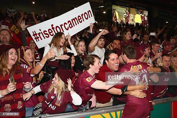 Michael Morgan of the Maroons celebrates with the crowd after victory during game three of the State of Origin series between the Queensland Maroons...
