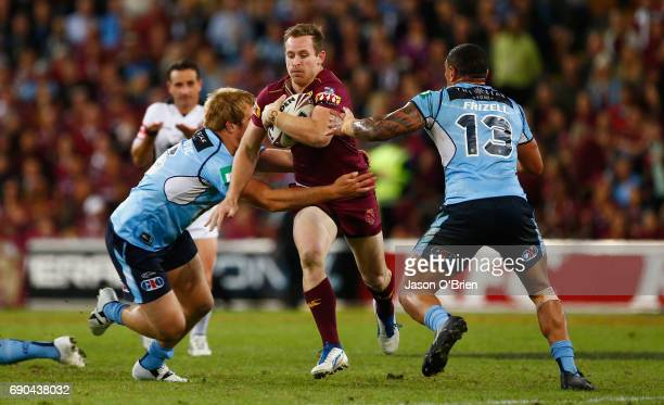 Michael Morgan of the maroons in action during game one of the State Of Origin series between the Queensland Maroons and the New South Wales Blues at...