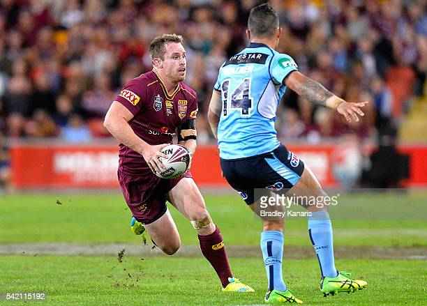 Michael Morgan of the Maroons takes on the defence during game two of the State Of Origin series between the Queensland Maroons and the New South...