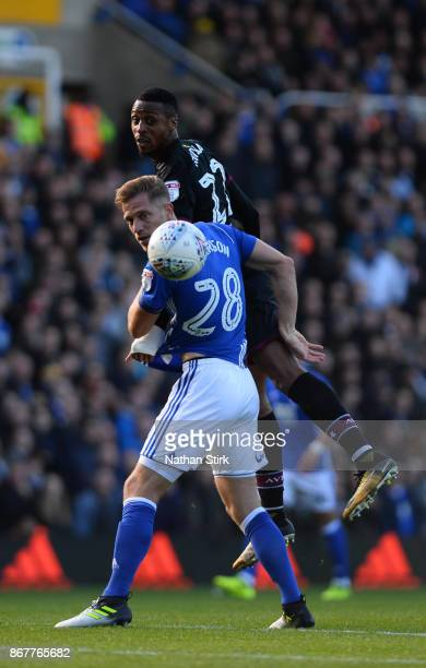 Michael Morrison of Birmingham and Jonathan Kodjia of Aston Villa in action during the Sky Bet Championship match between Birmingham City and Aston...