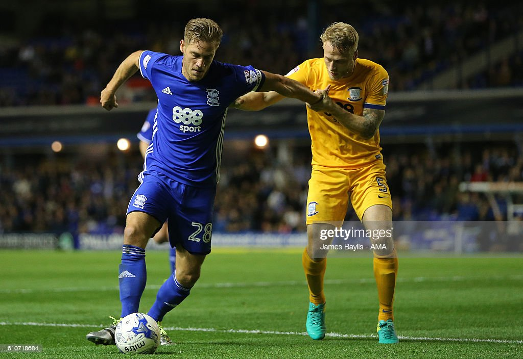 Michael Morrison of Birmingham City and Tom Clarke of Preston North End during the Sky Bet Championship match between Birmingham City and Preston North End at St Andrews (stadium) on September 27, 2016 in Birmingham, England.