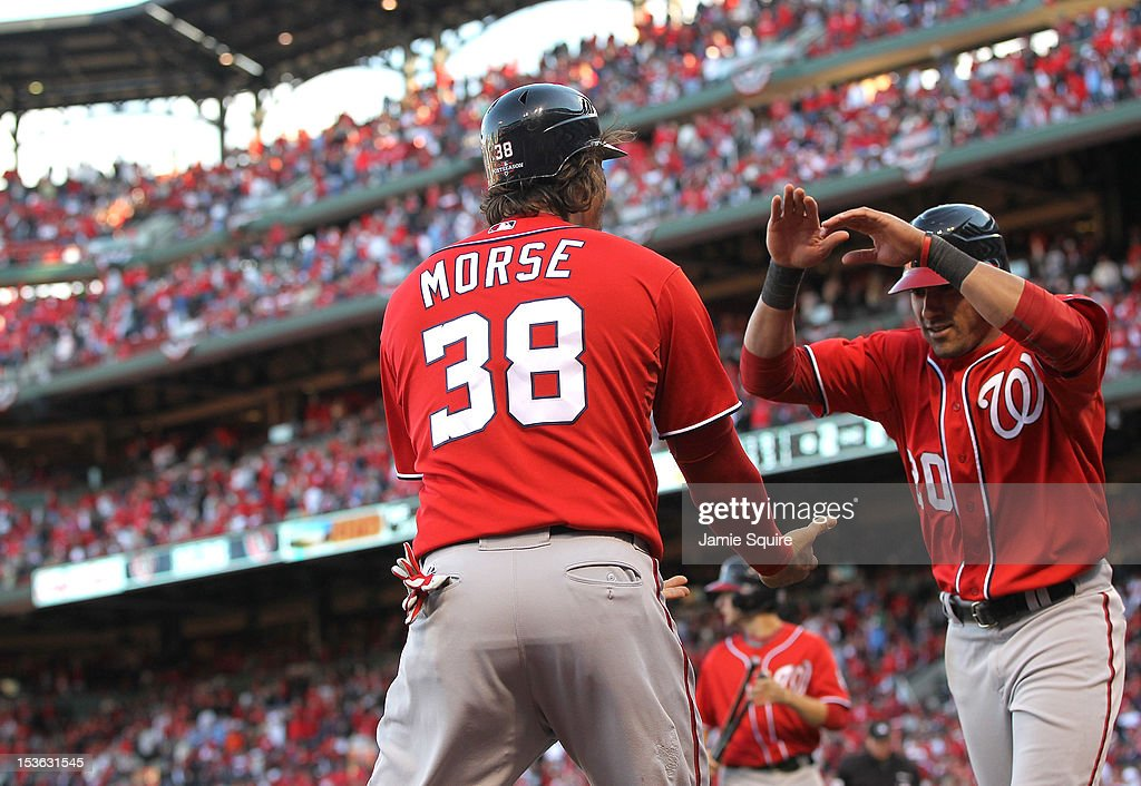 Michael Morse #38 and <a gi-track='captionPersonalityLinkClicked' href=/galleries/search?phrase=Ian+Desmond&family=editorial&specificpeople=835572 ng-click='$event.stopPropagation()'>Ian Desmond</a> #20 of the Washington Nationals celebrate after scoring the tying and go ahead runs in the eighth inning against the St Louis Cardinals during Game One of the National League Division Series at Busch Stadium on October 7, 2012 in St Louis, Missouri.