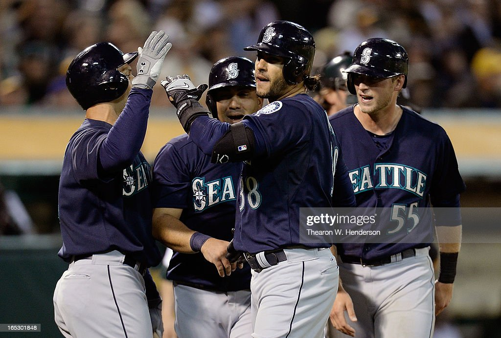 Michael Morse #38, Kendrys Morales #8, Raul Ibanez #28 and Michael Saunders #55 of the Seattle Mariners celebrate after Morse hit a three-run home run against the Oakland Athletics in the third inning at O.co Coliseum on April 2, 2013 in Oakland, California.