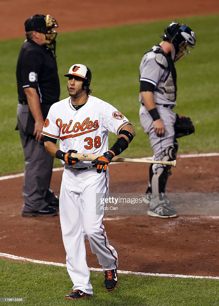 Michael Morse #38 of the Baltimore Orioles walks to the dugout after striking out looking during the second inning against the Chicago White Sox at Oriole Park at Camden Yards on September 5, 2013 in Baltimore, Maryland.