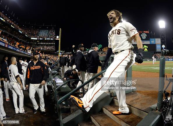 Michael Morse of the San Francisco Giants celebrates and takes a curtain call after hitting a solo home run in the eighth inning against the St Louis...