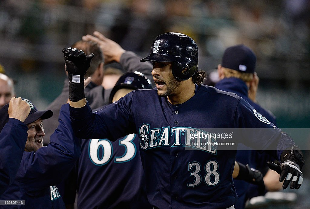 Michael Morse #38 of the Seattle Mariners celebrates after hitting his second home run of the game against the Oakland Athletics in the ninth inning at O.co Coliseum on April 2, 2013 in Oakland, California. The Mariners won the game 7-1.