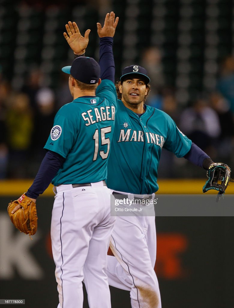 Michael Morse #38 of the Seattle Mariners celebrates with Kyle Seager #15 after defeating the Baltimore Orioles 6-2 at Safeco Field on April 29, 2013 in Seattle, Washington.