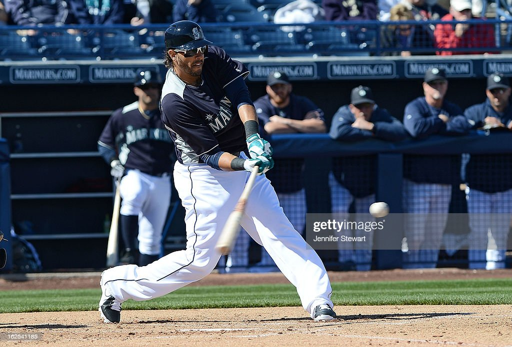 Michael Morse #38 of the Seattle Mariners hits a double in the spring training game against the in the San Diego Padres at Peoria Sports Complex on February 24, 2013 in Peoria, Arizona.