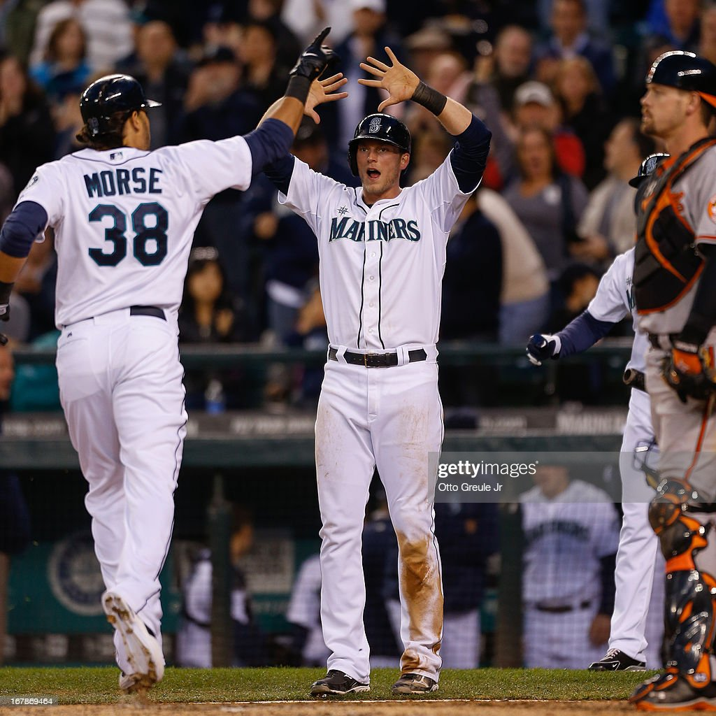 Michael Morse #38 of the Seattle Mariners is congratulated by Michael Saunders #55 after hitting a two-run home run against the Baltimore Orioles in the fourth inning at Safeco Field on May 1, 2013 in Seattle, Washington.