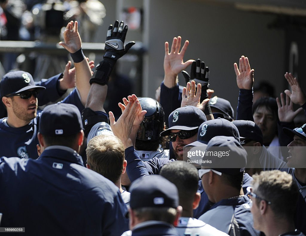 Michael Morse #38 of the Seattle Mariners is greeted by teammates after hitting a two-run homer against the Chicago White Sox in the first inning on April 7, 2013 at U.S. Cellular Field in Chicago, Illinois.