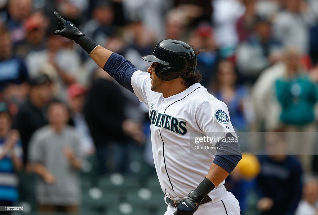 Michael Morse #38 of the Seattle Mariners points to the crowd as he crosses home plate on a game-winning solo home run in the eighth inning against the Los Angeles Angels of Anaheim at Safeco Field on April 28, 2013 in Seattle, Washington. The Mariners defeated the Angels 2-1.