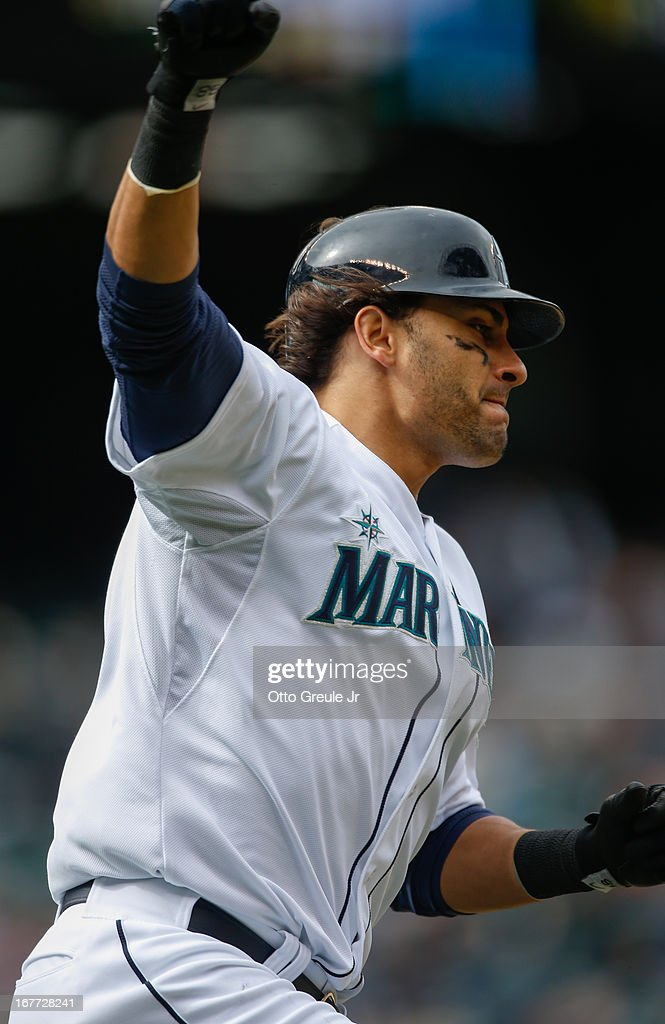 Michael Morse #38 of the Seattle Mariners pumps his fist as he rounds first base on a solo home run in the eighth inning against the Los Angeles Angels of Anaheim at Safeco Field on April 28, 2013 in Seattle, Washington.