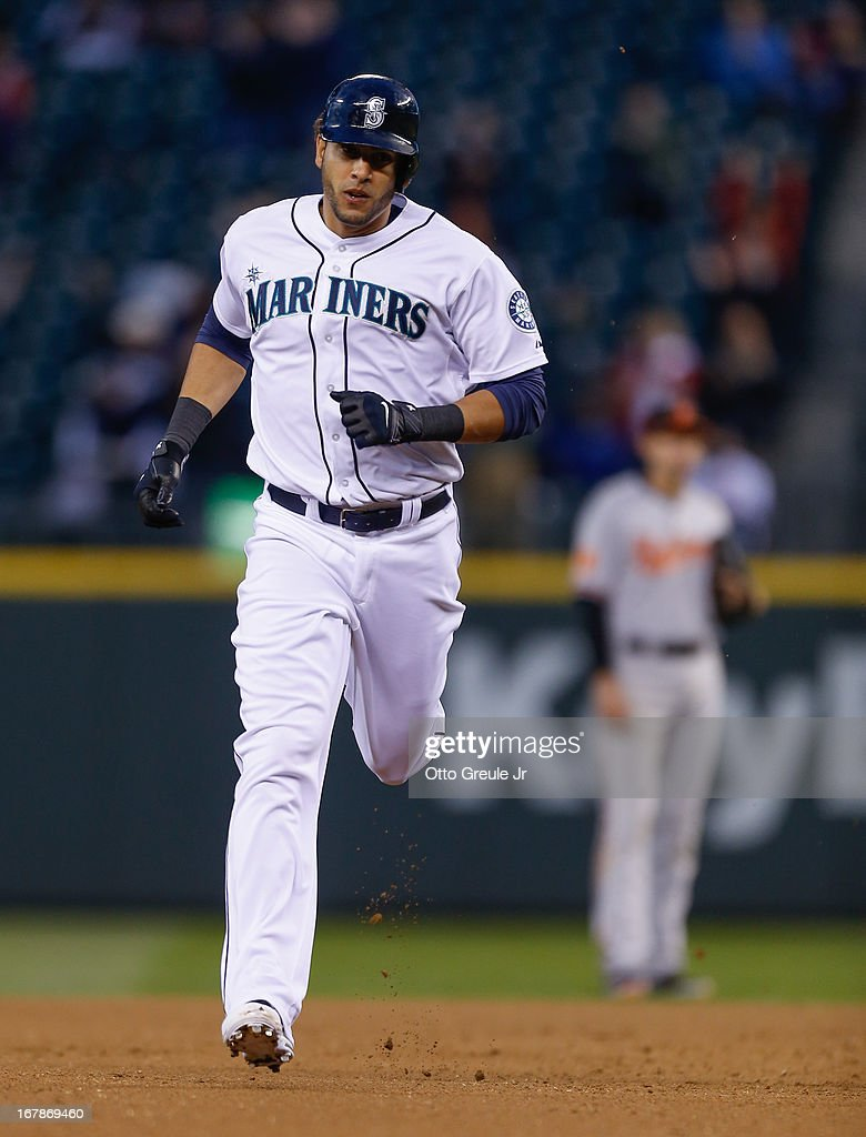 Michael Morse #38 of the Seattle Mariners rounds the bases after hitting a two-run home run against the Baltimore Orioles in the fourth inning at Safeco Field on May 1, 2013 in Seattle, Washington.
