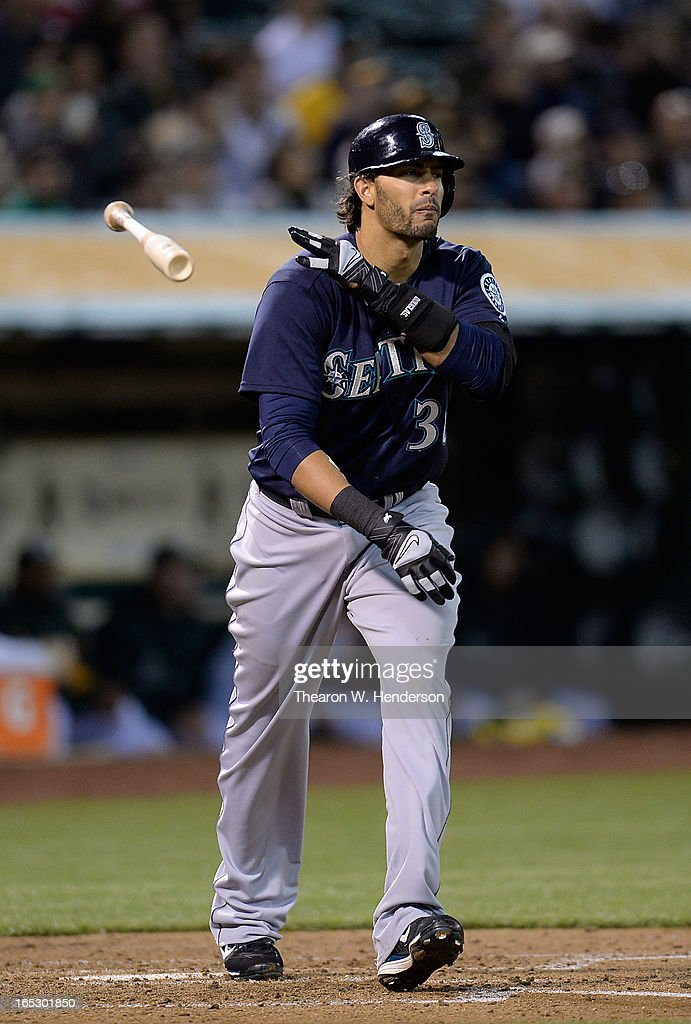Michael Morse #38 of the Seattle Mariners tosses his bat away as he watches his three-run home run against the Oakland Athletics in the third inning at O.co Coliseum on April 2, 2013 in Oakland, California.
