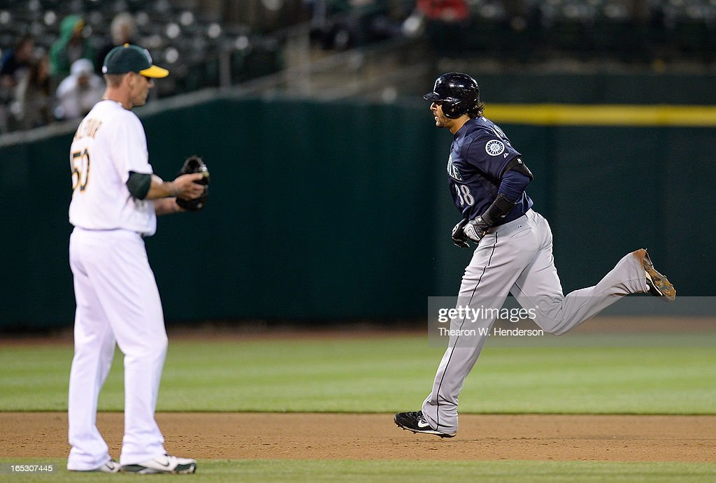 Michael Morse #38 of the Seattle Mariners trots around the bases after hitting his second home run of the game as pitcher Grant Balfour #50 of the Oakland Athletics looks on in the ninth inning at O.co Coliseum on April 2, 2013 in Oakland, California. The Mariners won the game 7-1.